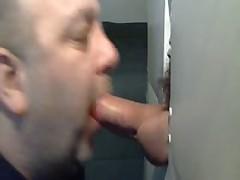 BEAR SUCKING BIG COCK AT GLORYHOLE